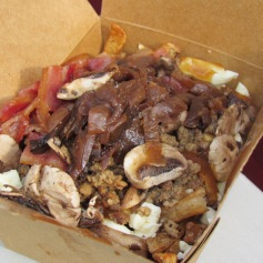 "Poutine à la ""The Canadian"", Montreal, Quebec (c) tanadia.com"